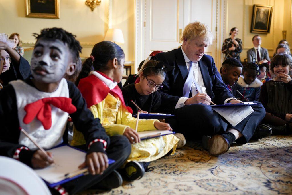 Prime Minister Boris Johnson with children celebrating World Book Day